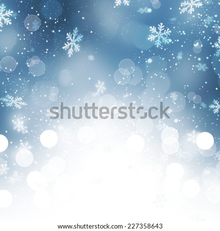 Winter Holiday Snow Background. Christmas Abstract Blue Defocused Backdrop with Snowflakes. Bokeh  - stock photo