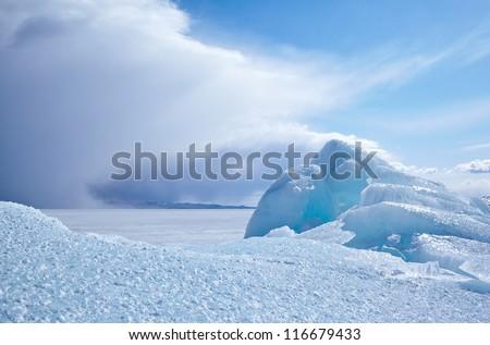 Winter ice landscape on siberian lake Baikal - stock photo