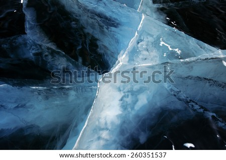 Winter. Ice on the surface of Lake Baikal. Ice thickness of about one meter. Cracks in the ice surface. Ice storm. Used toning of the photo.  - stock photo