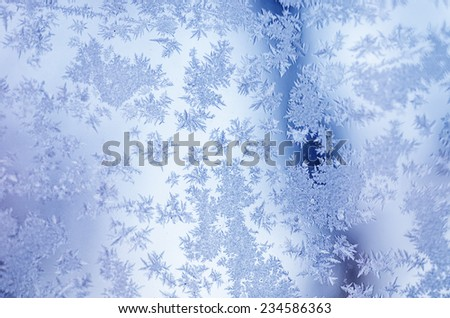 Winter iced blue pattern with bokeh, holiday seasonal background - stock photo