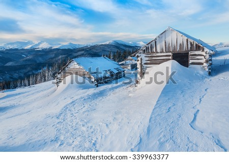 winter in mountain and abandoned (huts) cabins - stock photo