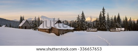 Winter in mountain village - stock photo