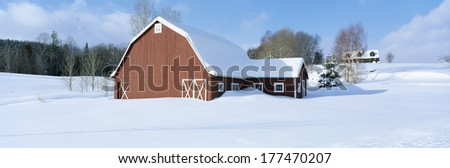 Winter in New England, Red Barn in Snow, South of Danville, Vermont - stock photo