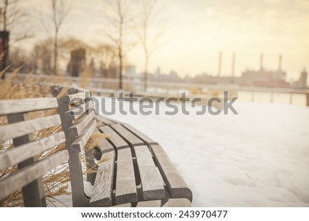 Winter in New York City. Empty benches. - stock photo