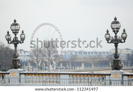 Winter in Paris. Pont Alexandre III covered with snow - stock photo