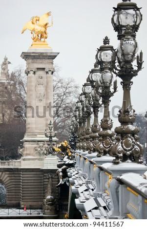 Winter in Paris. Pont Alexandre III under snow - stock photo