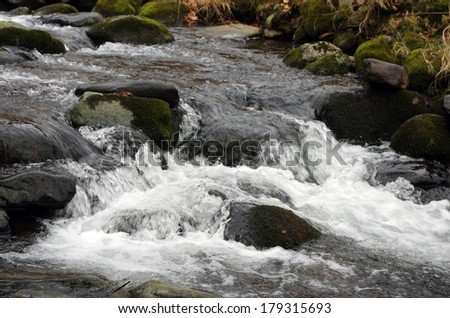 Winter is beginning at mountain river.  - stock photo
