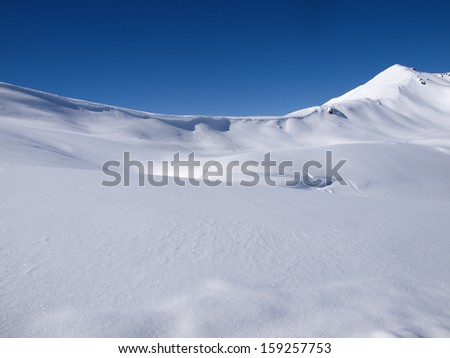 Winter landscape background high in the alps - stock photo