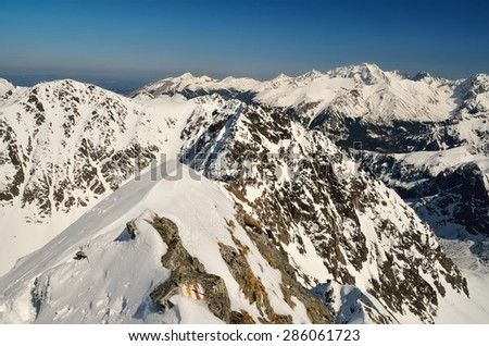 Winter landscape in mountains. View of the ridge over snowy summits, National Park in High Tatra Mountains. - stock photo