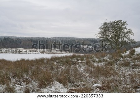 Winter landscape in the Scottish Westhighlands with a dark gloomy sky - stock photo