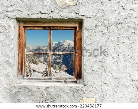 winter landscape in the wooden window - stock photo