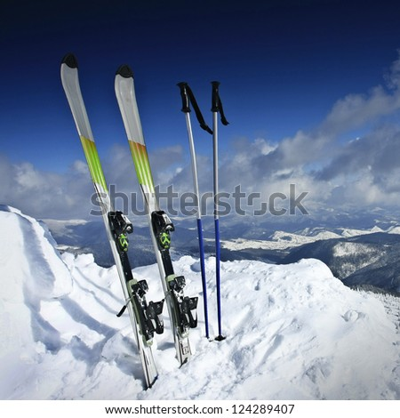 winter landscape, mountains and ski equipment - stock photo