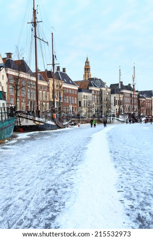 Winter landscape of a canal in a city - stock photo