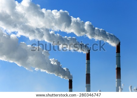 winter landscape smoke from the chimneys Zainsk TPP against the blue sky frosty misty morning - stock photo