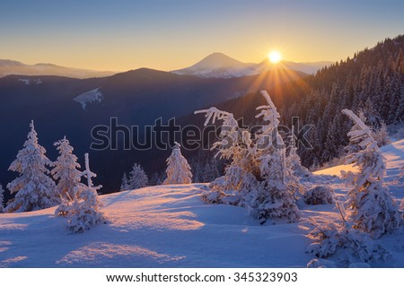 Winter landscape. Sunrise in the mountains. Beautiful World. Christmas scene. Carpathians, Ukraine, Europe - stock photo