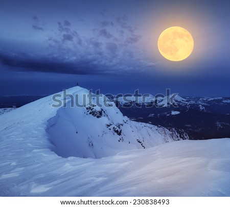 Winter landscape. The top of the rocky mountains. Night and the light of the full moon. Carpathian mountains, Ukraine, Europe - stock photo