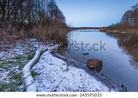 winter landscape with lake after sunset - stock photo