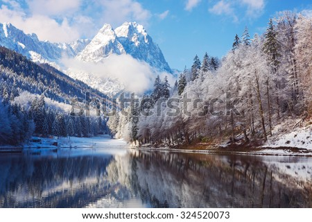 Winter landscape with lake and reflection - stock photo