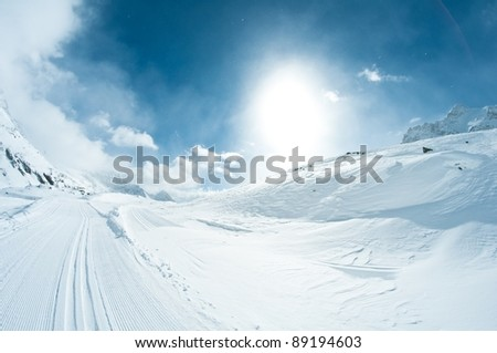 winter landscape with skiing tracks - stock photo