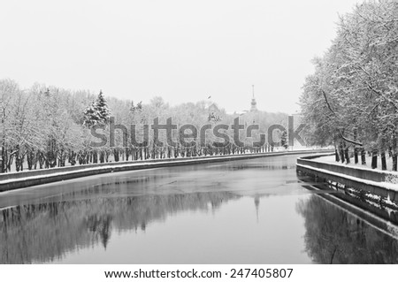 winter landscape with snow and river in city park - stock photo
