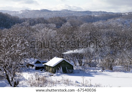 Winter landscape with the rural house (island Sakhalin) - stock photo