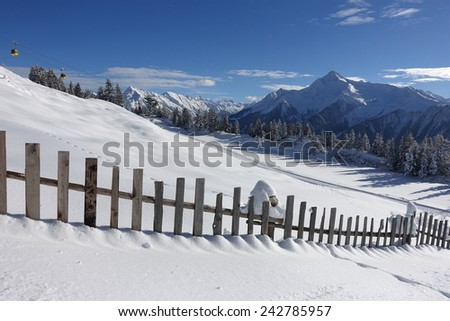 Winter landscape with wooden fence - stock photo