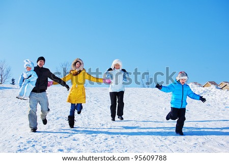 Winter leisure time for happy family - stock photo