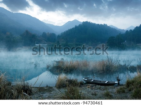 Winter morning, a mist on the lake. - stock photo