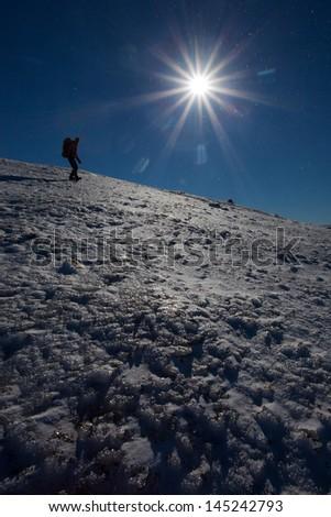 Winter mountain descend - stock photo