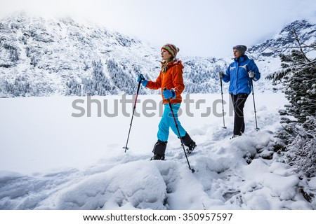 Winter mountain hike - Morskie Oko, Tatra Mountains, Poland - stock photo