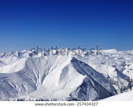Winter mountains and blue clear sky at nice day. Caucasus Mountains, Georgia. Ski resort Gudauri. - stock photo