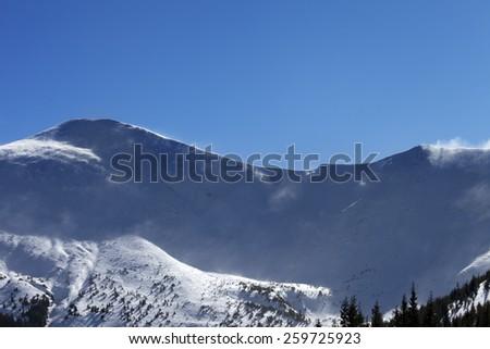 Winter mountains at sunny windy day. Ukraine, Carpathian Mountains. Mount Hoverla.  - stock photo