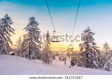 Winter mountains panorama with ski slopes and ski lifts near Vogel ski center, Slovenia - stock photo