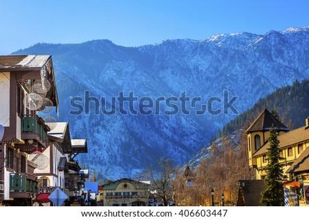 Winter Mountains Snow German Buildings Orange Maple Leaves Leavenworth Washington - stock photo