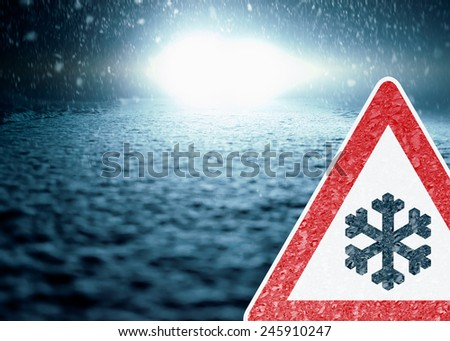 Winter Night Driving - Winter Road - Caution - Abstract winter background with warning sign - Snow covered road at night. - stock photo
