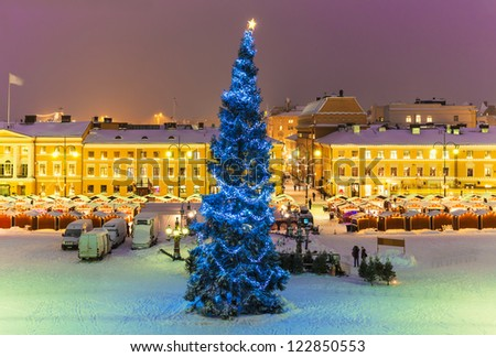 Winter night scenery of Senate Square with Christmas Tree and holiday market in Helsinki, Finland - stock photo