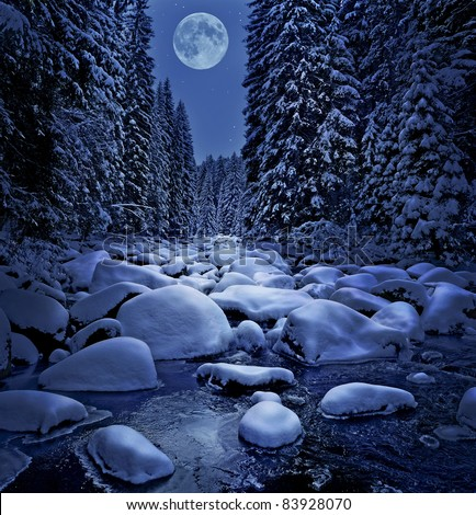 winter night scenery with mountain river - stock photo