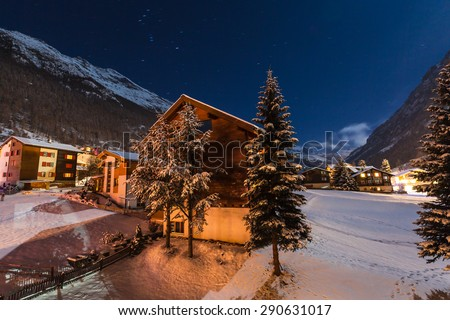 Winter night view with clear sky of the tasch valley, the gate to Zermatt, Switzerland - stock photo