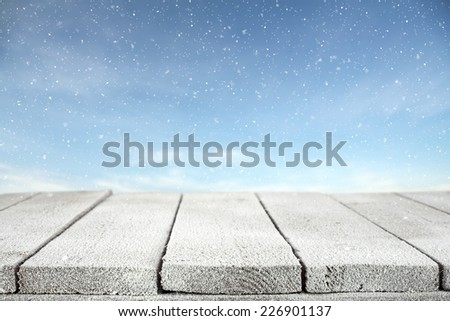 winter photo of blue sky with snow and table with frost  - stock photo