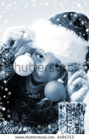 winter portrait of a beautiful woman with some christmas tree balls and snowflakes - stock photo