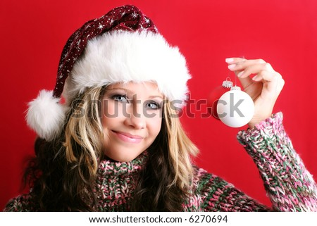 winter portrait of a beautiful young smiling woman with some christmas tree balls - stock photo