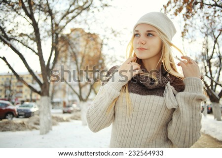 winter portrait of a cute blonde teen - stock photo