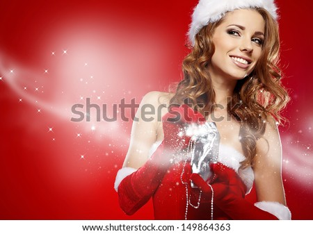 winter portrait of a santa woman with a christmas gift  - stock photo