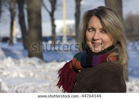 Winter portrait of a young woman - stock photo