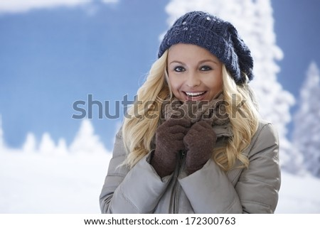 Winter portrait of attractive young blonde woman smiling happy in winter clothes. - stock photo