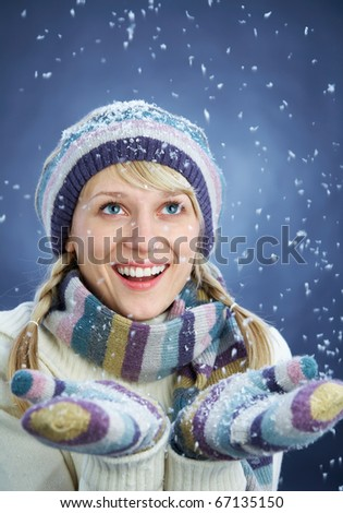 WINTER PORTRAIT OF BEAUTIFUL SMILING WOMAN WITH SNOWFLAKES - stock photo