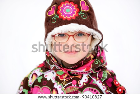 Winter portrait of happy child girl in colorful warm clothes, isolated on white background - stock photo