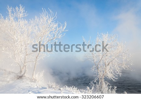Winter river. Ice and fog.  fog formed of minute ice crystals. - stock photo