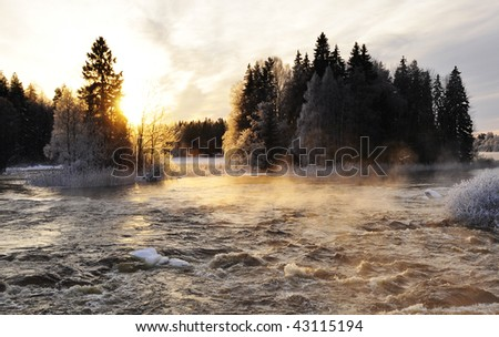 Winter river landscape at sunset - stock photo