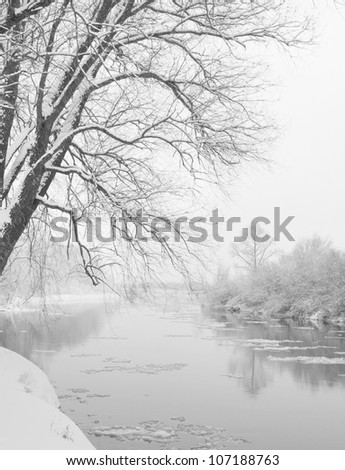 winter river, when it is snowing - stock photo